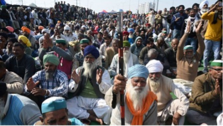 Figure 2 Thousands of farmers blocked a road in Ghazipur near Delhi on Saturday. Credit BBC News (Getty Images)